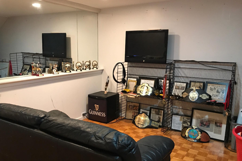 Our Office with Martial Arts and MMA Belts