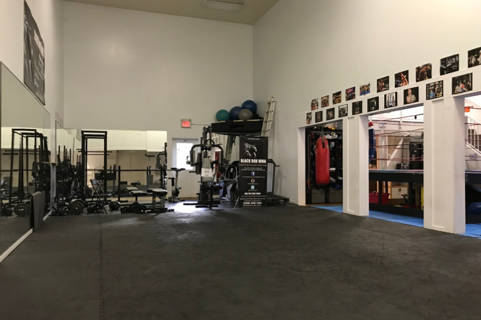 BlackBox MMA Gym with Weight Lifting Equipment and Open Mat area